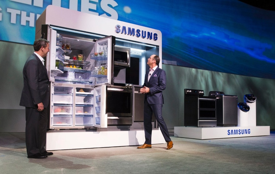 John Herrington (L), senior vice president of Samsung Electronics America, and Tim Baxter, president of Samsung Electronics America, pose by Samsung Chef Collection kitchen appliances at a Samsung Electronics news conference during the 2015 International Consumer Electronics Show (CES) in Las Vegas, Nevada January 5, 2015. REUTERS/Steve Marcus (UNITED STATES - Tags: SCIENCE TECHNOLOGY BUSINESS) - RTR4K61T