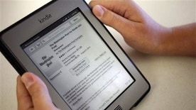 FILE - In this Aug. 5, 2013, file photo, the Washington Post for Kindle application is displayed for purchase on an Amazon Kindle in New York. A recent poll by survey by Media Insight Project, a collaboration of the American Press Institute and the Associated Press-NORC Center for Public Affairs Research, shows that about 40 percent of U.S. adults ages 18-34 pay for at least some of the news they read, whether it's a print newspaper, a digital news app or an email newsletter. (AP Photo/Karly Domb Sadof, File)