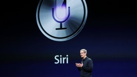 CEO Tim Cook talks about Siri during an Apple event in San Francisco, California March 7, 2012.  REUTERS/Robert Galbraith  (UNITED STATES - Tags: SCIENCE TECHNOLOGY) - RTR2YZMO