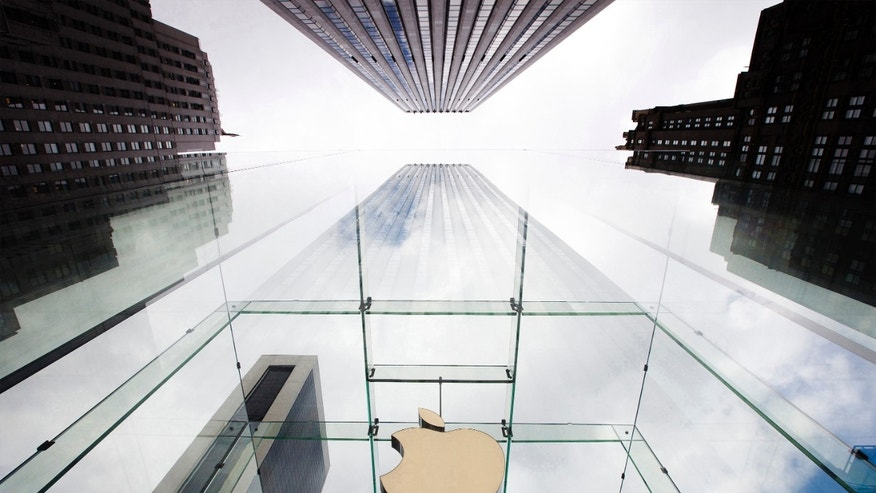 File photo - The Apple logo hangs in a glass enclosure above the 5th Ave Apple Store in New York, Sept. 20, 2012.