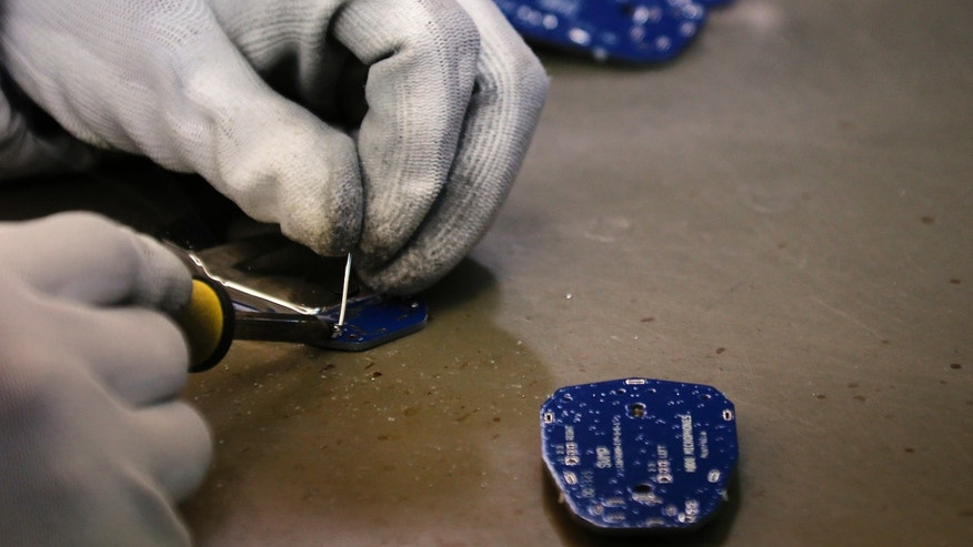 File photo - A worker at the Rode Microphone factory located in western Sydney, uses a soldering iron as she works on components August 15, 2013. (REUTERS/David Gray)