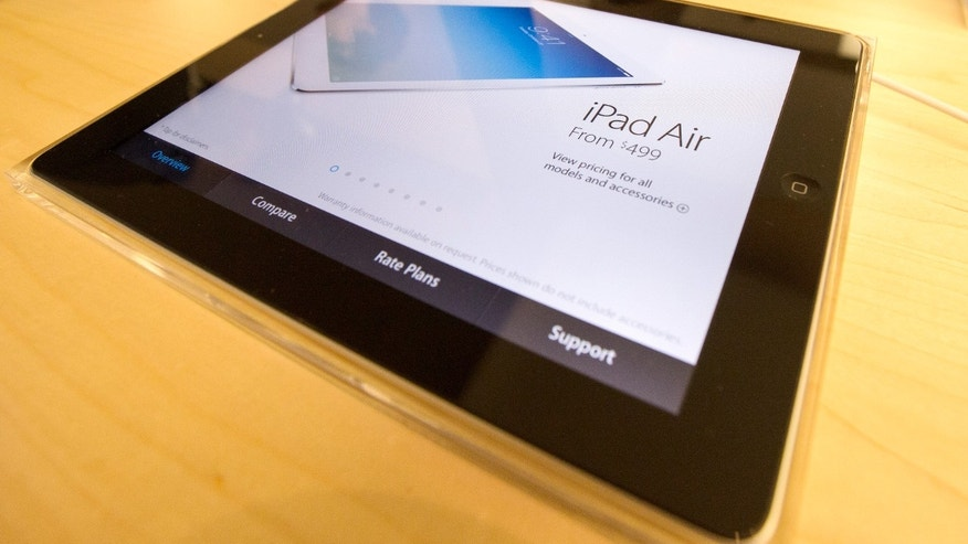 File photo - A display shows a new Apple iPad Air tablet inside the Apple Store on New York's fifth avenue, Nov. 1, 2013. (REUTERS/Mike Segar)