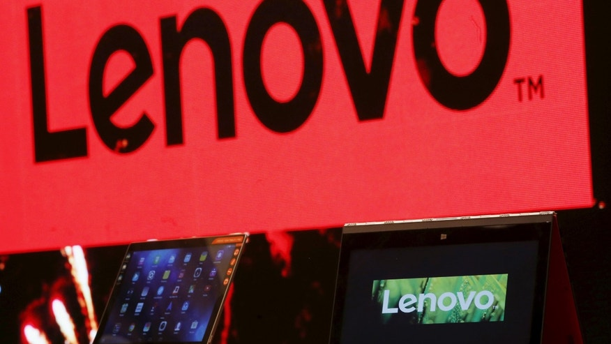 File photo - A Lenovo ultrabook and a tablet are displayed during a news conference in Hong Kong, China May 21, 2015. (REUTERS/Bobby Yip)