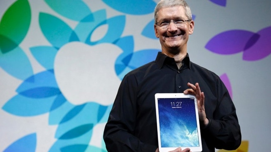File photo - Oct. 22, 2013: Apple CEO Tim Cook introduces the iPad Air in San Francisco. (AP Photo/Marcio Jose Sanchez)