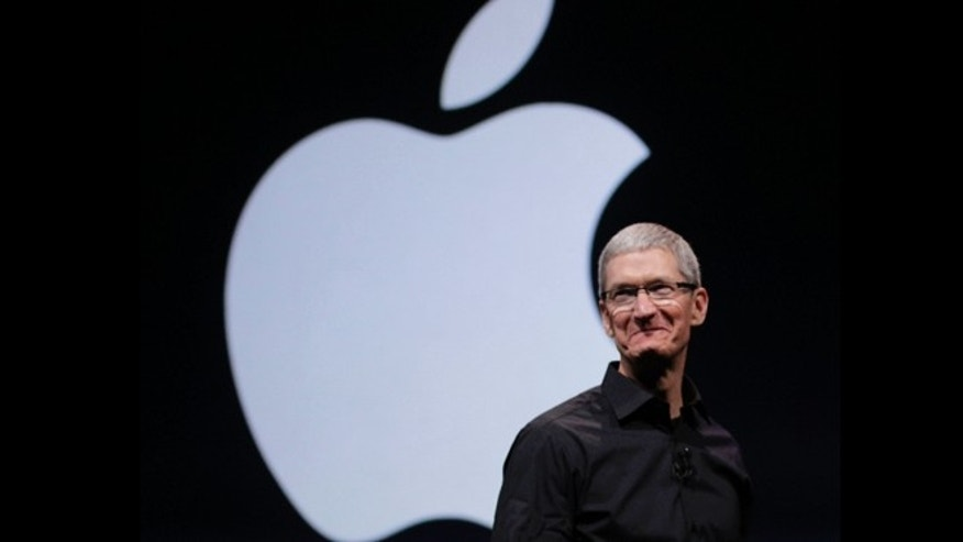 File photo - Sept. 12, 2012: Apple CEO Tim Cook walks on stage at the beginning of an event in San Francisco