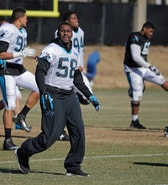 Carolina Panthers's Thomas Davis stretches during NFL football practice, Friday, Jan. 29, 2016, in Charlotte, N.C. (AP Photo/Chuck Burton)