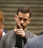 Jack Dorsey, CEO of Square and CEO of Twitter, arrives at the New York Stock Exchange for the IPO of Square Inc., in New York November 19, 2015. Square Inc priced shares at $9 for its initial public offering, about 25 percent less than it had hoped, as it struggled to win over investors skeptical about its business and valuation before trading begins on Thursday. REUTERS/Lucas Jackson - RTS7YY2