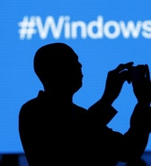 A Microsoft delegate takes a picture during the launch of the Windows 10 operating system in Kenya's capital Nairobi, July 29, 2015. Microsoft Corp's launch of its first new operating system in almost three years, designed to work across laptops, desktop and smartphones, won mostly positive reviews for its user-friendly and feature-packed interface. REUTERS/Thomas Mukoya - RTX1MBCZ