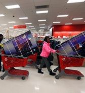 Thanksgiving Day holiday shoppers line up with television sets on discount at the Target retail store in Chicago, Illinois, November 28, 2013. About 140 million people are expected to shop over the four-day weekend, according to the National Retail Federation. REUTERS/Jeff Haynes  (UNITED STATES - Tags: BUSINESS TPX IMAGES OF THE DAY) - RTX15X0E