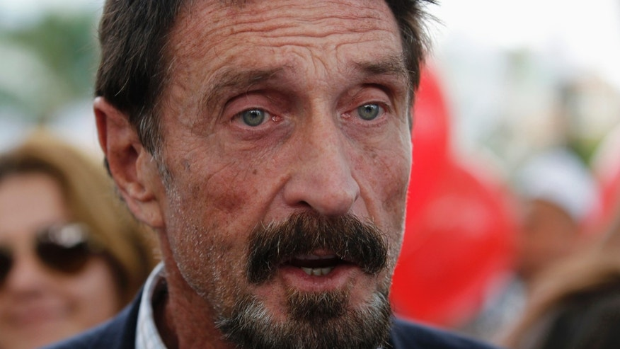 File photo - Computer software pioneer John McAfee speaks with reporters outside his hotel in Miami Beach, Florida December 13, 2012.(REUTERS/Joe Skipper)