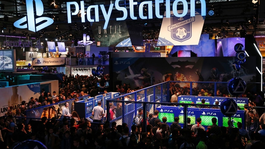 File photo - Visitors play games on PlayStation 4 (PS4) at the Paris Games Week, a trade fair for video games in Paris, France, October 28, 2015. (REUTERS/Benoit Tessier)