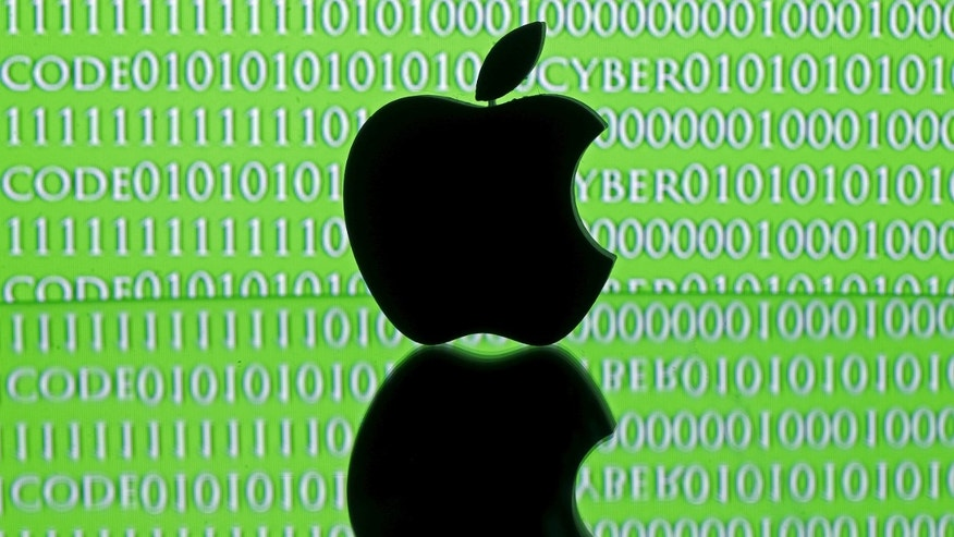 File photo - A 3D printed Apple logo is seen in front of a displayed cyber code in this illustration taken Feb. 26, 2016. (REUTERS/Dado Ruvic/Illustration)