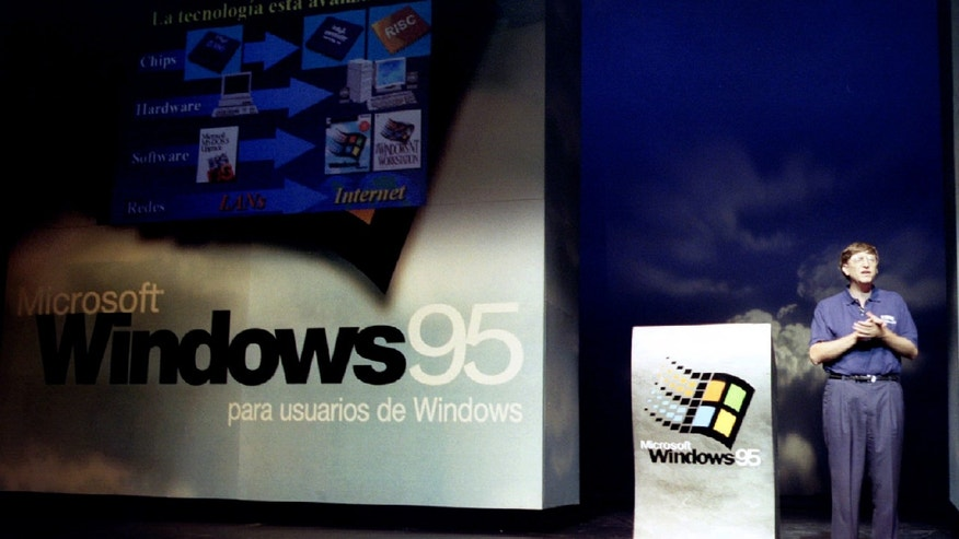 Bill Gates, chairman of software giant Microsoft, stands on stage during the launching of the new Windows 95 software to Spanish clients Sept. 5 at a Madrid theatre (Reuters).