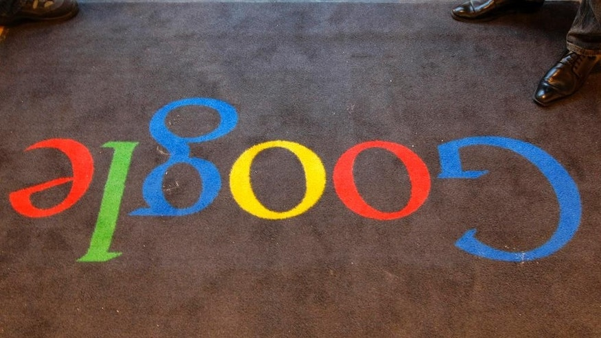 FILE - In this Dec. 6, 2011 file photo, the Google logo is seen on the carpet at Google France offices before its inauguration, in Paris, France. (AP Photo/Jacques Brinon, Pool, File)