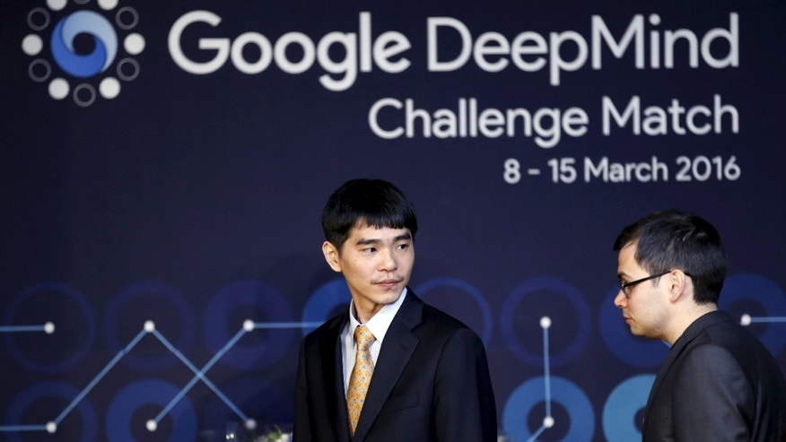 The world's top Go player Lee Sedol and Demis Hassabis, the CEO of DeepMind Technologies and developer of AlphaGO, arrive at an award ceremony for the Google DeepMind Challenge Match against Google's artificial intelligence program AlphaGo in Seoul, South Korea, March 15, 2016. (REUTERS/Kim Hong-Ji)