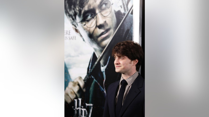 "File photo - Actor Daniel Radcliffe poses at the premiere of ""Harry Potter and the Deathly Hallows: Part 1"" in New York Nov. 15, 2010. (REUTERS/Shannon Stapleton)"