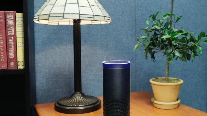 FILE - This July 29, 2015, file photo made in New York shows Amazon's Echo, a digital assistant that continually listens for commands such as for a song, a sports score or the weather. Starting Thursday, March 17, 2016, Amazon's voice assistant will tell you how well you slept and how much more exercise you need, at least if you have a Fitbit fitness tracker and an Alexa-compatible device, such as Amazon's Echo speaker and Fire TV streaming devices. (AP Photo/Mark Lennihan, File)