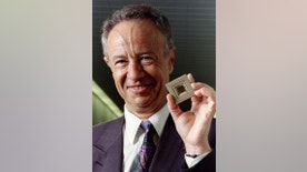 Intel Corp. President and CEO Andy Grove shows off the company's long-awaited Pentium microprocessor, a new generation chip that promises to revolutionize personal computers and protect Intel, the leading chip maker, from rivals. The Pentium will run up to five times faster that Intel's 486 chip that has become an industry standard in personal computers - RTXF2CV