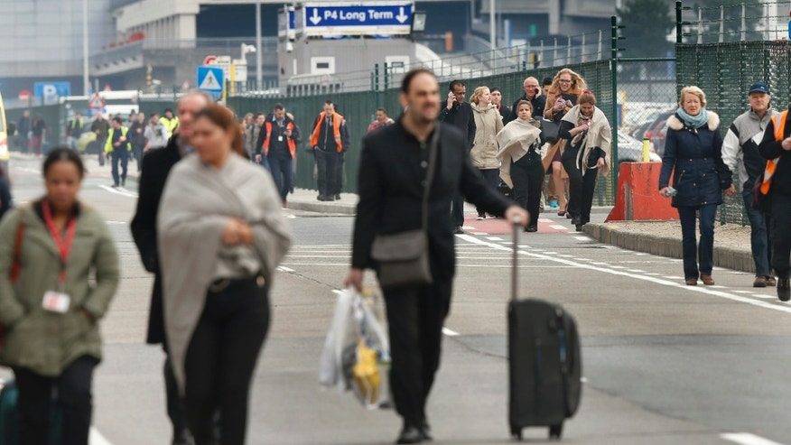 People leave the scene of explosions at Zaventem airport near Brussels, Belgium, March 22, 2016. (REUTERS/Francois Lenoir)