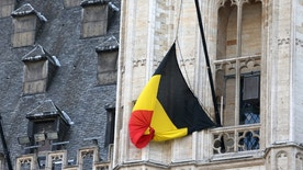 A Belgian flag flies at half-mast following bomb attacks s in Brussels, Belgium, March 22, 2016.    REUTERS/Charles Platiau - RTSBPYI