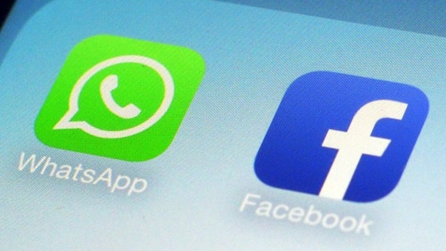 The logos of WhatsApp and its parent company Facebook.