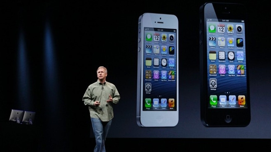 File photo - Sept. 12, 2012: Phil Schiller, Apple's senior vice president of worldwide marketing, speaks on stage during an introduction of the iPhone 5 in San Francisco. (AP Photo/Eric Risberg)