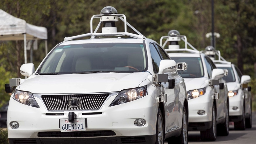 A line of Lexus SUVs equipped with Google self-driving sensors await test riders during a media preview of Google's prototype autonomous vehicles in Mountain View, California September 29, 2015. (REUTERS/Elijah Nouvelage)