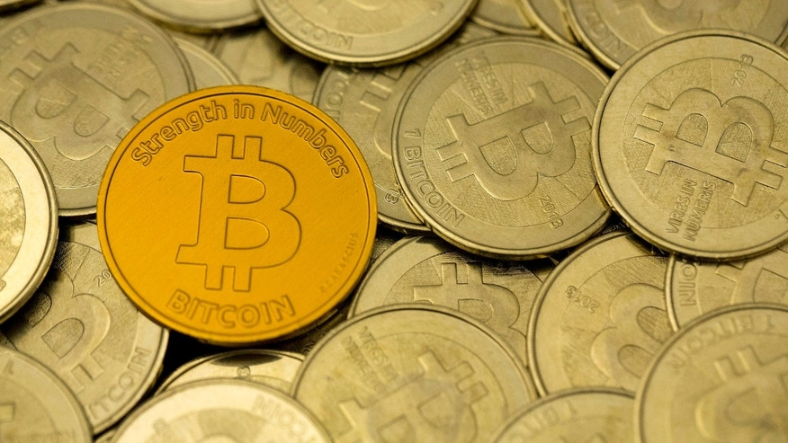 Photo illustration - Some of Bitcoin enthusiast Mike Caldwell's coins are pictured at his office in this photo illustration in Sandy, Utah, Jan. 31, 2014. (REUTERS/Jim Urquhart)
