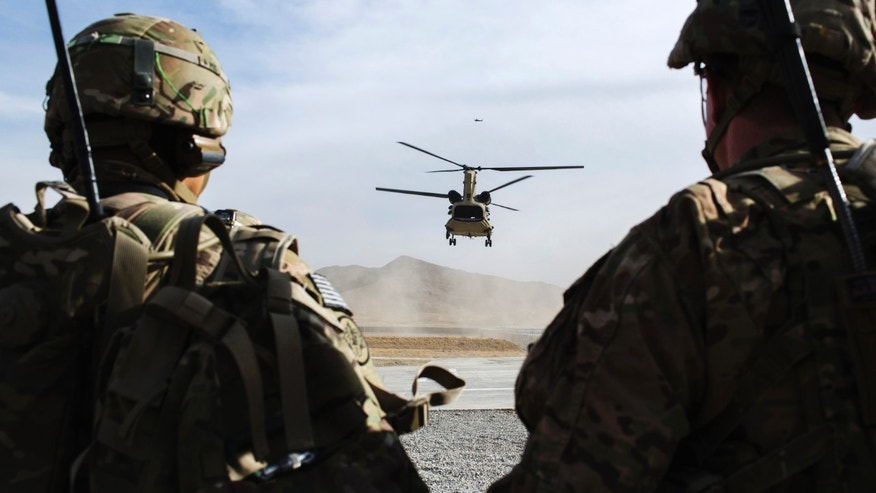 File photo - U.S. soldiers from the 3rd Cavalry Regiment watch as CH-47 Chinook helicopter from the 82nd Combat Aviation Brigade lands after an advising mission at the Afghan National Army headquarters for the 203rd Corps in the Paktia province of Afghanistan December 21, 2014. (REUTERS/Lucas Jackson)