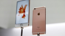 The new Apple iPhone 6S and 6S Plus are displayed during an Apple media event in San Francisco, California, September 9, 2015. REUTERS/Beck Diefenbach - RTSE3H