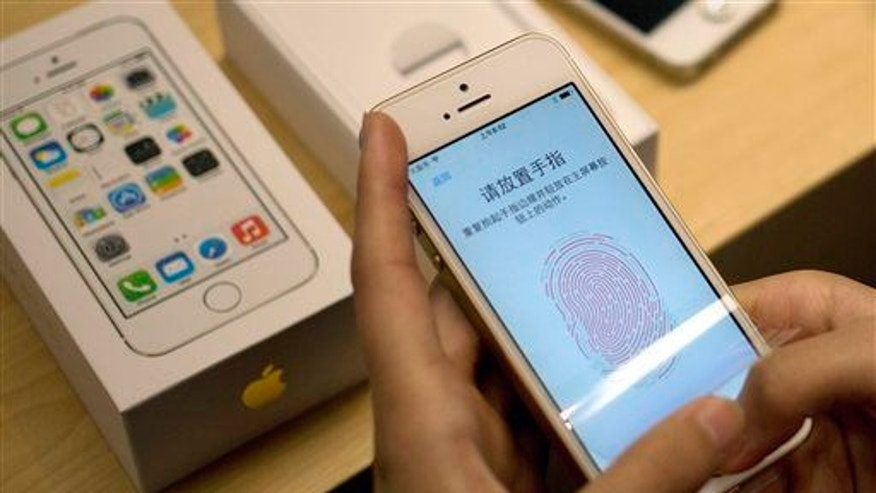 Apple's fingerprint technology on display at a store in Beijing.