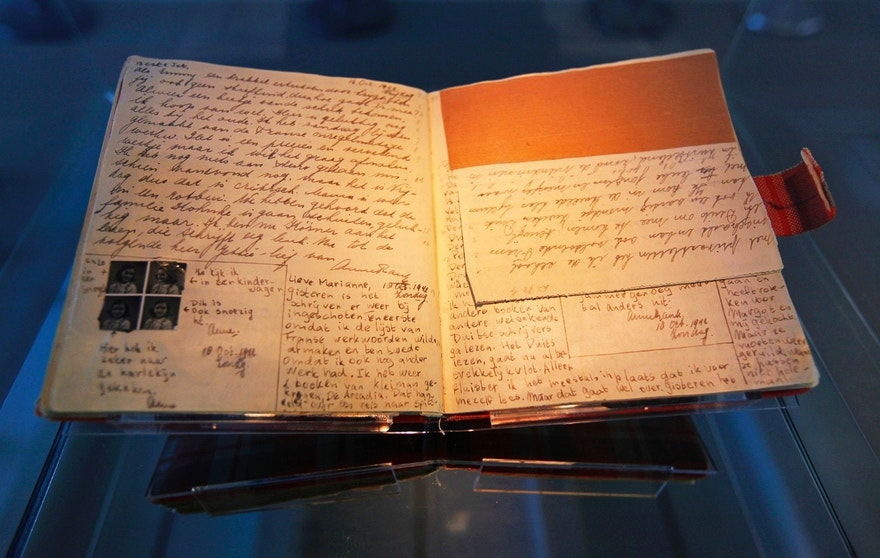The well-known first diary of Anne Frank sits on display in the Anne Frank House in Amsterdam April 28, 2010. Fifty years after the opening of the Anne Frank House museum, which has more than 1 million visitors every year, the museum is launching an online virtual tour of what life was like at the back of 263 Prinsengracht in Amsterdam. To match Reuters Life! ANNEFRANK-TOUR/   REUTERS/Cris Toala Olivares (NETHERLANDS - Tags: SOCIETY TRAVEL) - RTR2D877