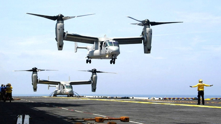 V-22 Osprey aircraft operate in close proximity during recent flight deck developmental testing aboard the amphibious assault ship USS Iwo Jima in the Atlantic Ocean in 2004. (Navy/Journalist 1st Class Mike Jones)
