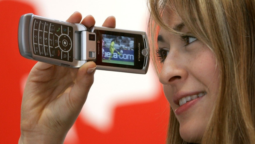 File photo - A model presents a TV service on a Motorola RAZR V3x phone with UMTS feature by Vodafone at the CeBIT computer fair in the northern German town of Hanover March 7, 2006. (REUTERS/Fabrizio Bensch)