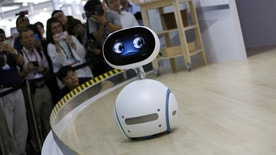 Taiwanese electronics manufacturer ASUS's Zenbo home robot demonstrates during the annual Computex computer exhibition in Taipei, Taiwan June 1, 2016. REUTERS/Tyrone Siu - RTX2F30E