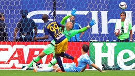Jun 28, 2015; New York, NY, USA; New York Red Bulls forward Bradley Wright-Phillips (99) scores a goal past New York City FC goalkeeper Josh Saunders (12) during the second half of a soccer game at Yankee Stadium. The New York Red Bulls defeated the New York City FC 3 - 1. Mandatory Credit: Adam Hunger-USA TODAY Sports - RTX1I673