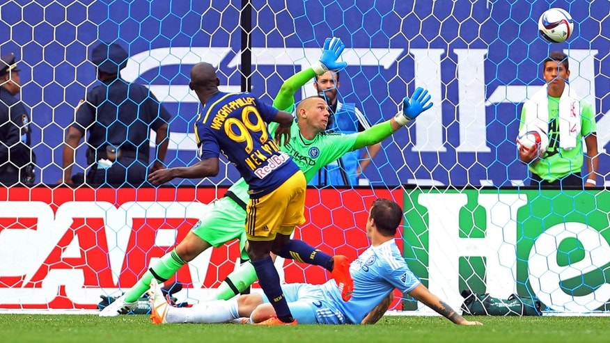 File photo - Jun 28, 2015; New York Red Bulls forward Bradley Wright-Phillips (99) scores a goal past New York City FC goalkeeper Josh Saunders (12) during the second half of a soccer game at Yankee Stadium, New York. (Adam Hunger-USA TODAY Sports)