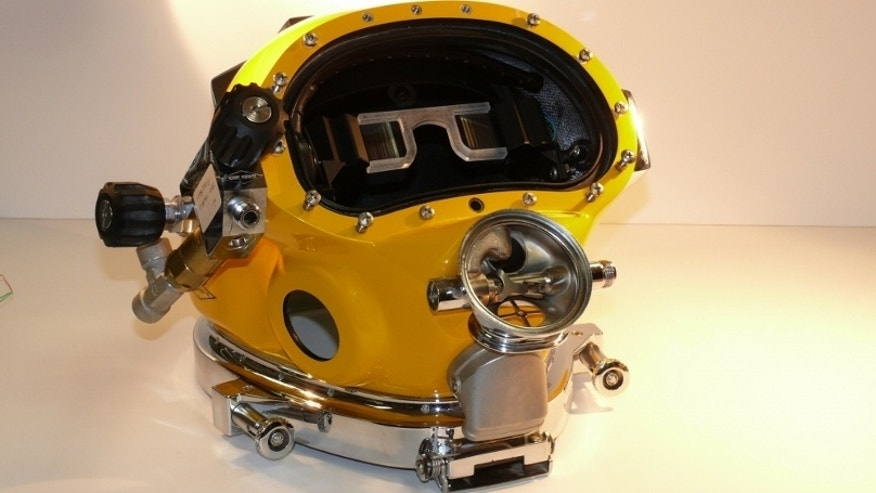 Prototype of the Divers Augmented Vision Display (DVAD) positioned within a dive helmet.