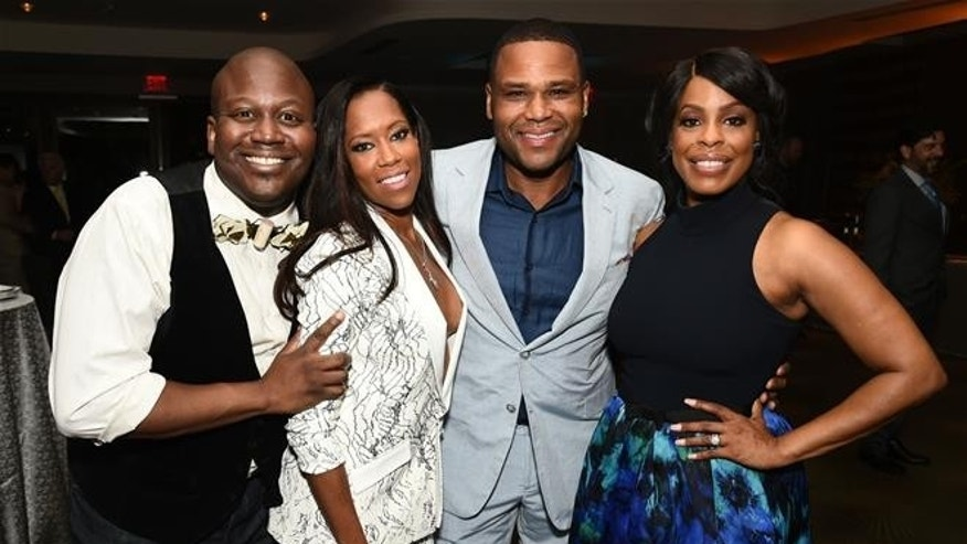 Titus Burgess, from left, Regina King, Anthony Anderson, and Niecy Nash attend the Television Academy's 67th Emmy Awards Performers Nominee Reception in 2015.