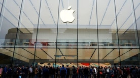 People line up outside an Apple store as the iPhone SE goes on sale in China, in Hangzhou, Zhejiang province, March 31, 2016. REUTERS/China Daily/File Photo ATTENTION EDITORS - THIS PICTURE WAS PROVIDED BY A THIRD PARTY. CHINA OUT. NO COMMERCIAL OR EDITORIAL SALES IN CHINA.           TPX IMAGES OF THE DAY      - RTX2BV7P