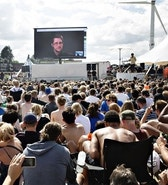 "Whistleblower Edward Snowden of the US, speaks to the crowd on a gigant screen at the Roskilde Festival in Roskilde, Denmark, Tuesday, June 28. 2016. ""You are being watched all the time and you have no privacy"", Snowden said via a video link from his exile in Russia."