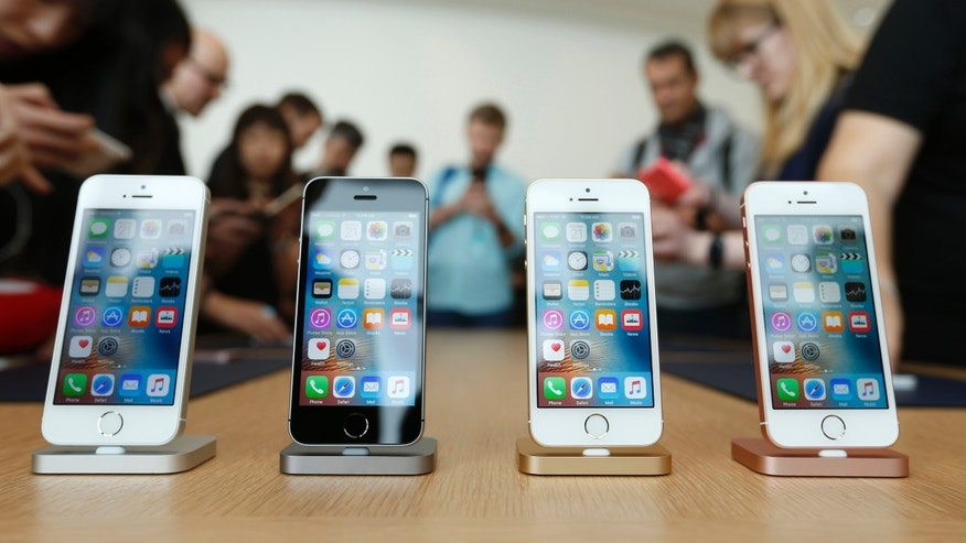 The new iPhone SE is seen on display during an event at the Apple headquarters in Cupertino, California March 21, 2016.