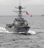 """The US Navy guided-missile destroyer USS Lassen, which sailed within 12 nautical miles of artificial islands built by China in the South China Sea on October 27, 2015, is pictured in the Pacific Ocean in a November 2009 photo provided by the U.S. Navy. US Navy/CPO John Hageman/Handout via Reuters/File Photo ATTENTION EDITORS - FOR EDITORIAL USE ONLY. NOT FOR SALE FOR MARKETING OR ADVERTISING CAMPAIGNS. THIS IMAGE HAS BEEN SUPPLIED BY A THIRD PARTY. IT IS DISTRIBUTED, EXACTLY AS RECEIVED BY REUTERS, AS A SERVICE TO CLIENTS  FROM THE FILES PACKAGE - SEARCH """"SOUTH CHINA SEA FILES"""" FOR ALL IMAGES - RTX2K9DK"""