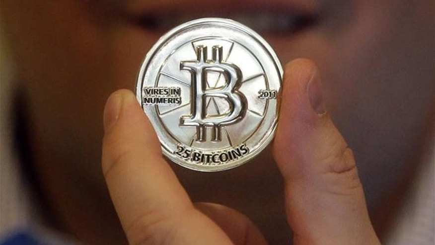 In this April 3, 2013, photo, a 25-bitcoin token is shown.