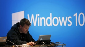 File photo - A man works on a laptop computer near a Windows 10 display at Microsoft Build in San Francisco, Calif. April 29, 2015.