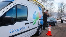 A technician gets cabling out of his truck to install Google Fiber in a residential home in Provo, Utah, January 2, 2014. Provo is one of three cities Google is currently building and installing gigabit internet and television service for business and residential use.  REUTERS/George Frey (UNITED STATES - Tags: BUSINESS TELECOMS) - RTX17190