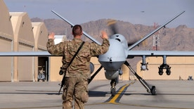 A U.S. airman guides a U.S. Air Force MQ-9 Reaper drone as it taxis to the runway at Kandahar Airfield, Afghanistan March 9, 2016.  To match Exclusive AFGHANISTAN-DRONES/      REUTERS/Josh Smith/File photo - RTX2AKO8