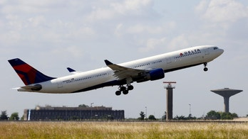 A Delta Air Lines Airbus A330 aircraft takes off at the Charles de Gaulle airport in Roissy, France, August 9, 2016. REUTERS/Jacky Naegelen         - RTSMOQ8