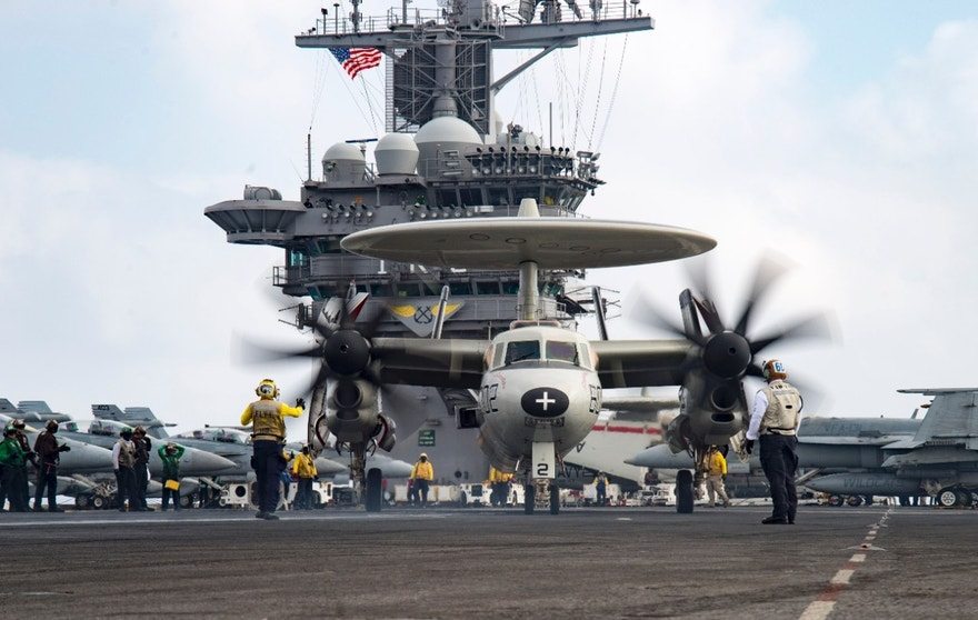 160628-N-KK394-129 MEDITERRANEAN SEA (June 28, 2016) Aviation Boatswain's Mate (Handling) 2nd Class Keyonnia Cook directs an E2-C Hawkeye assigned to the Screwtops of Airborne Early Warning Squadron (VAW) 123 on the flight deck of the aircraft carrier USS Dwight D. Eisenhower (CVN 69). Dwight D. Eisenhower is deployed in support of Operation Inherent Resolve, maritime security operations and theater security operation efforts in the U.S. 6th Fleet area of operations. (U.S. Navy photo by Mass Communication Specialist 3rd Class Anderson W. Branch/Released)
