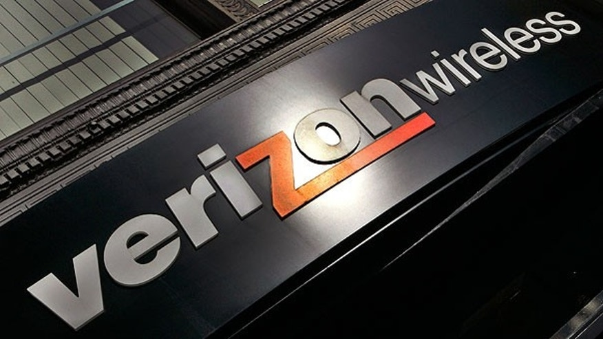 In this Oct. 30, 2006, file photo, a Verizon Wireless store sign is seen in a Portland, Ore.